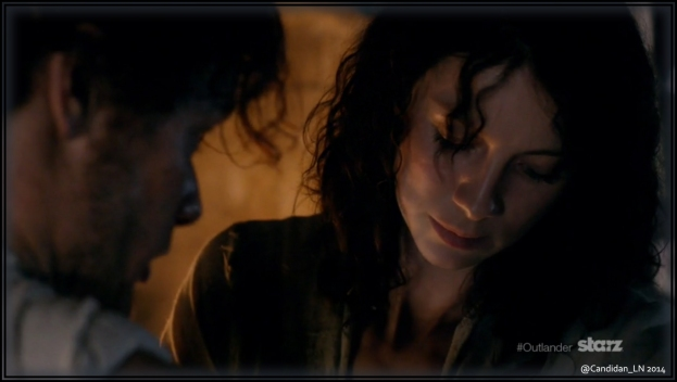 Claire (Caitriona Balfe) tends to Jamie's (Sam Heughan) wounds shortly after arriving at Leoch.