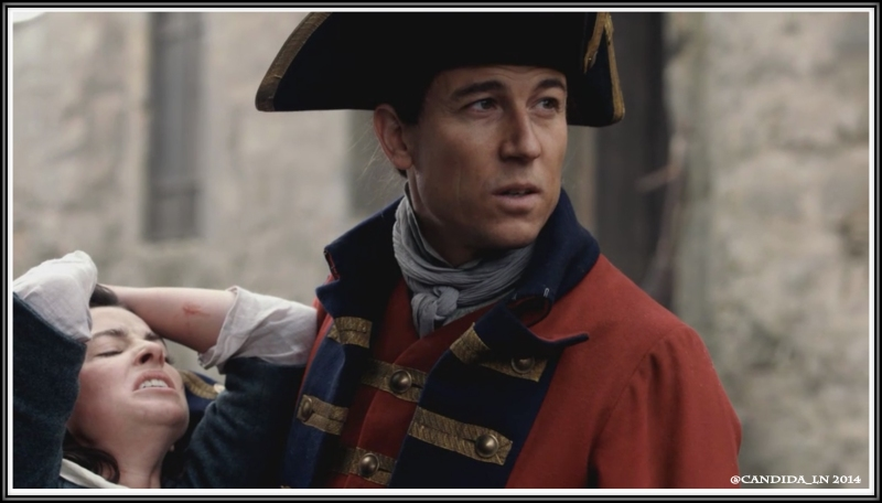 "Captain Randall (Tobias Menzies) gets ready to ""Take a closer look"" at Jenny Fraser (Laura Donnelly)."