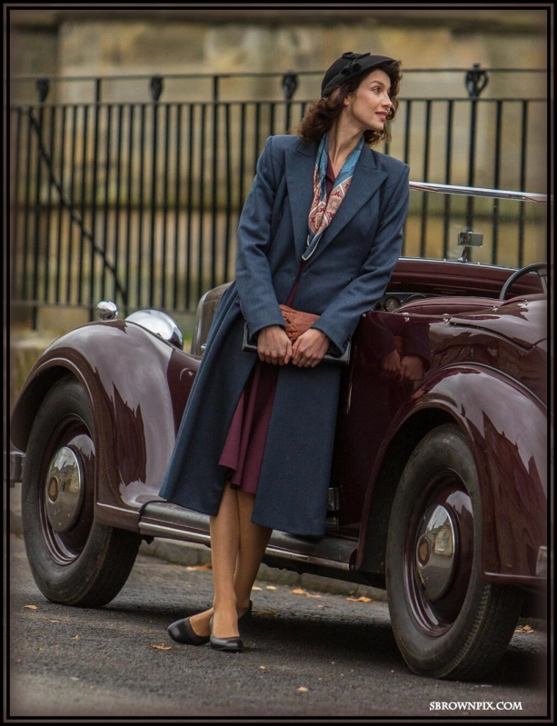 Our first vision of Claire Randall (Caitriona Balfe) in her much sought-after blue  coat.