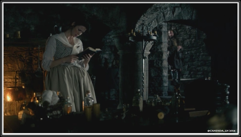 Claire (Caitriona Balfe) peruses the previous occupant's medical journal while Angus keeps a close eye (Stephen Walters).