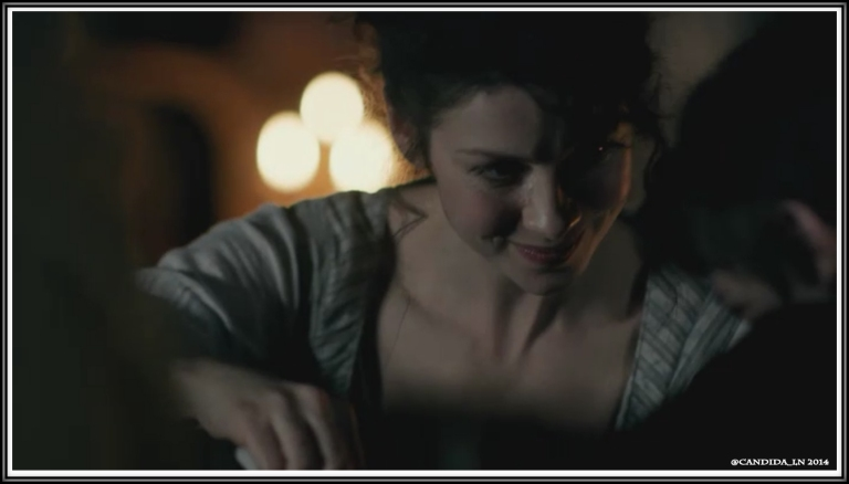 Claire (Caitriona Balfe) aids a young lad with an injury to his hand.