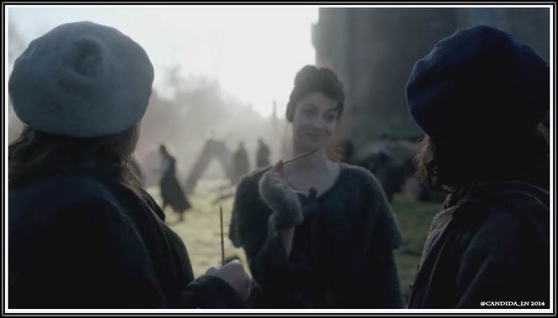 Claire (Caitriona Balfe) has Angus () and Rupert draw draws for first dibs on the laundress. Expression: Gotcha, Rupert!