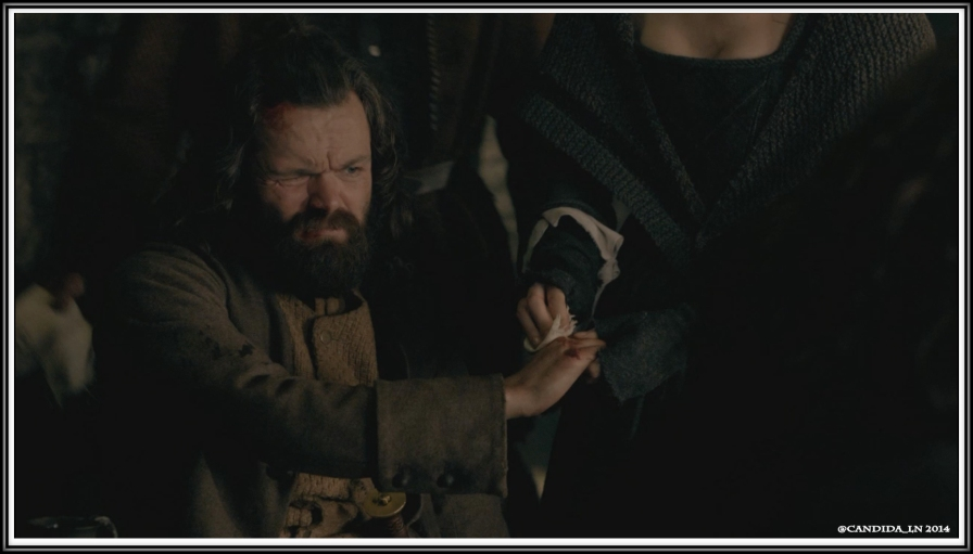 Angus (Stephen Walters) gets first aid from Claire (Caitriona Balfe).
