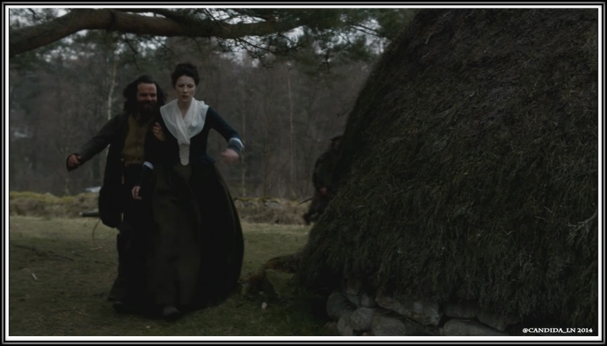 Angus (Stephen Walters) forces Claire (Caitrion Balfe) back to camp after finding her visiting with the village women.