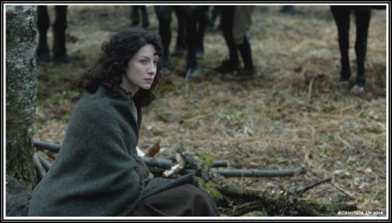 Claire (Caitriona Balfe) sits outside the camp fire.