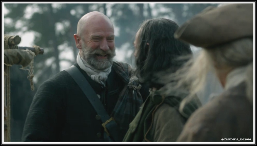 Dougal (Graham McTavish) laughing with the villagers.