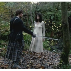 Sam Heughan as James Fraser & Caitriona Balfe as Claire Randall