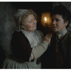 Annette Badland as Mrs. Fitz and Daniel Kerr as Tammas Baxter