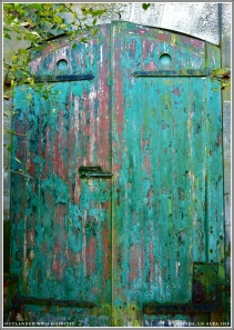 One of several stable doors leading to stalls.