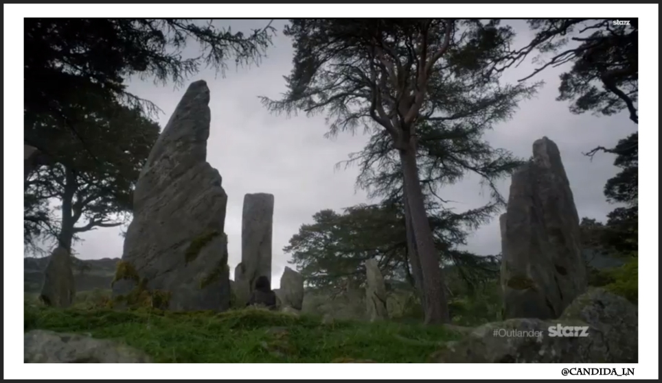 Claire (Caitriona Balfe) sits pondering near the stones. WTH?